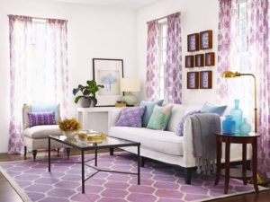 living room with purple carpet and drapes